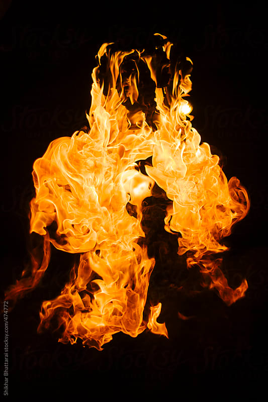 Fire against a dark background. by Shikhar Bhattarai for Stocksy United