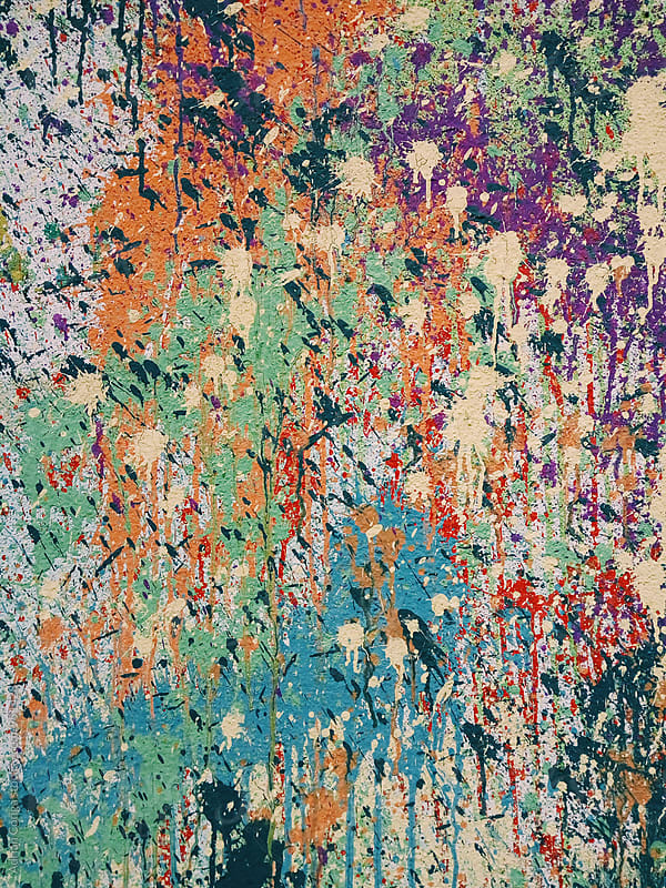 Paint splashed on a wall, colorful paint texture  by Adrian Cotiga for Stocksy United