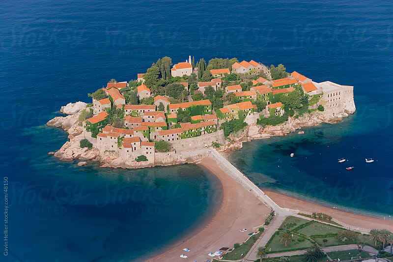 Eastern Europe, Balkans, Montenegro, The Budva Riviera, elevated view of the Island of Sveti Stefan  by Gavin Hellier for Stocksy United