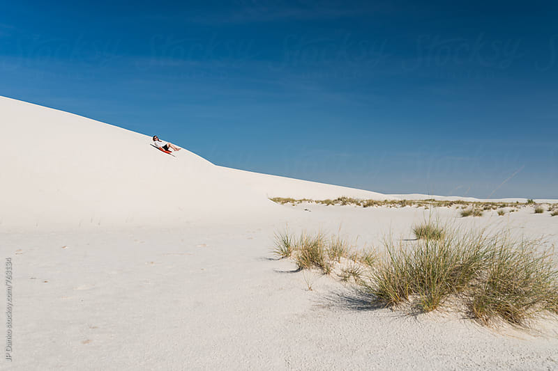 Woman Sliding Down Hill Sand Sledding In White Sands National Monument New Mexico by JP Danko for Stocksy United