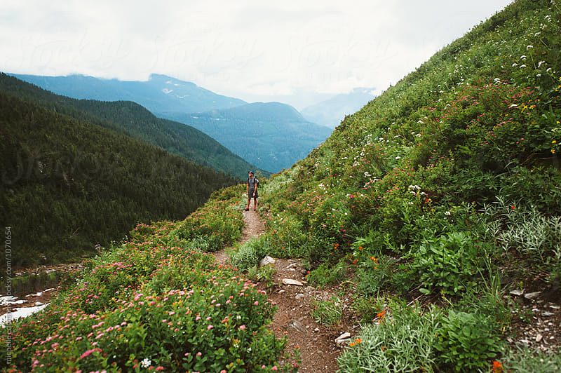 Hiker/Backpacker on a Trail in the Cascade Mountains of Washington by michelle edmonds for Stocksy United