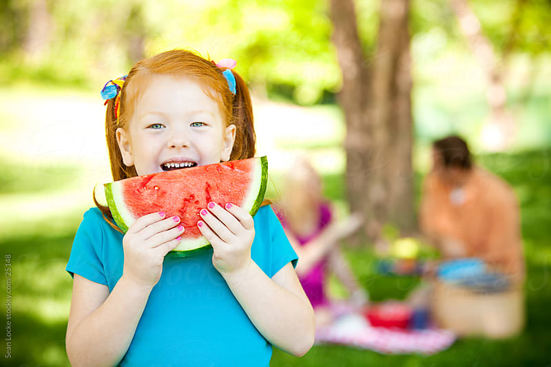 Park: Little Girl Hungry for Watermelon by Sean Locke for Stocksy United