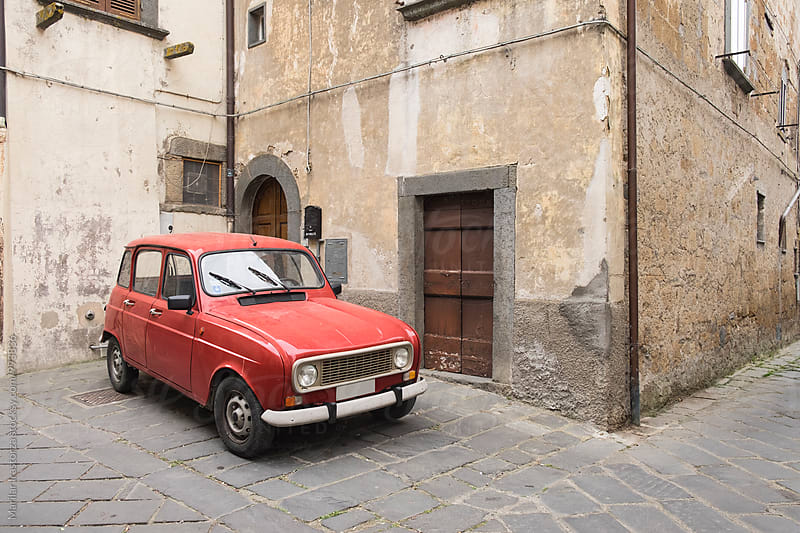 Vintage car in an italian village by Marilar Irastorza for Stocksy United