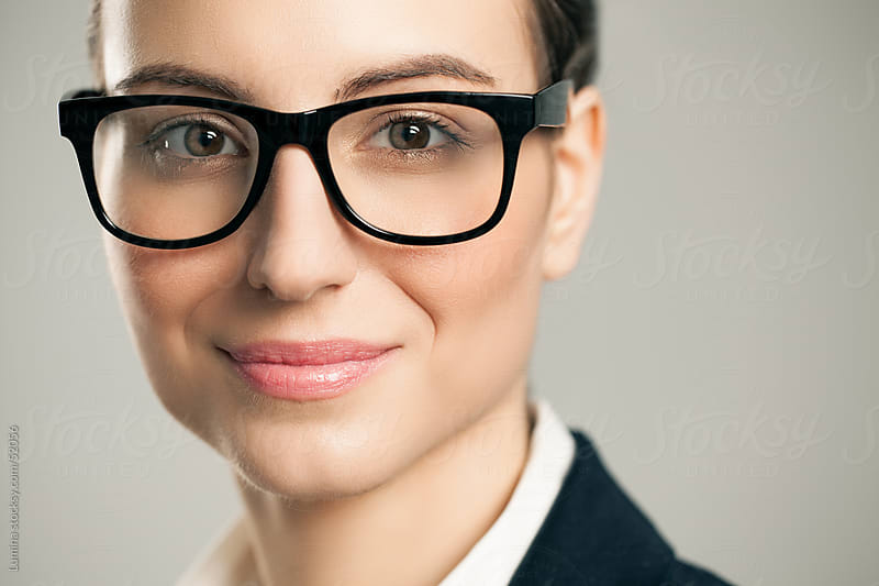 Portrait of a Young Businesswoman Wearing Glasses by Lumina for Stocksy United