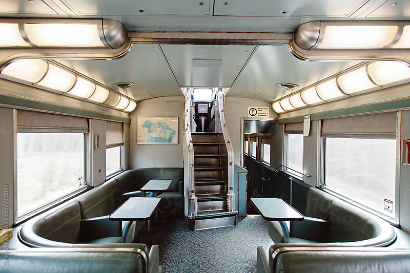 Retro lounge area on travelling train by Carey Shaw for Stocksy United