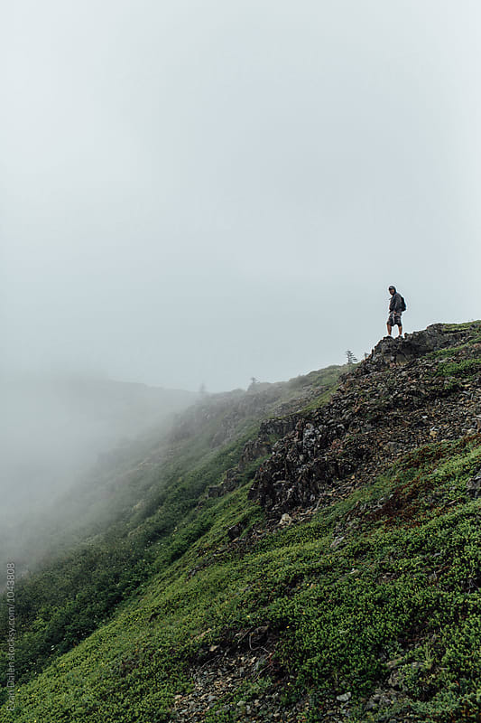 Man Standing on Misty Mountainside by Evan Dalen for Stocksy United