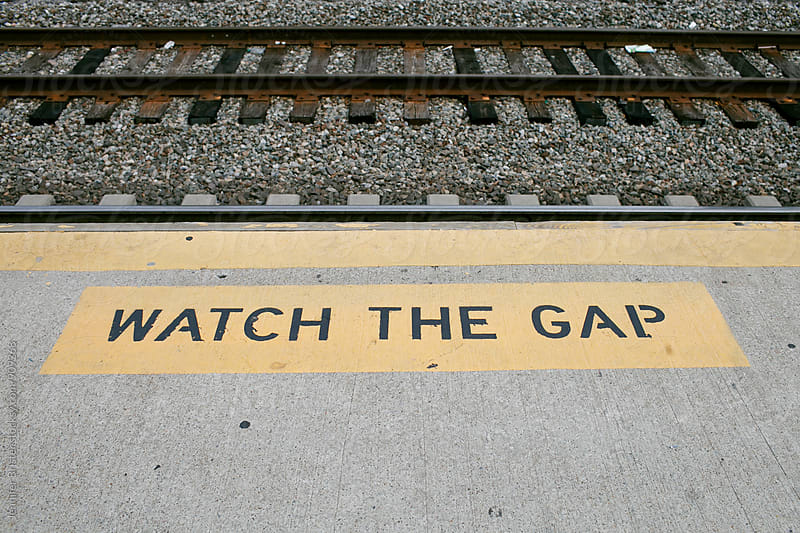 Watch the gap sign next to tracks by Jen Brister for Stocksy United