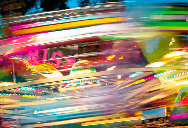 fun park ride motion blur background by Sonja Lekovic for Stocksy United