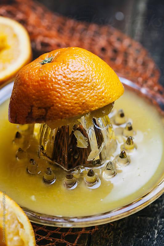 Freshly squeezed orange juice. by Darren Muir for Stocksy United