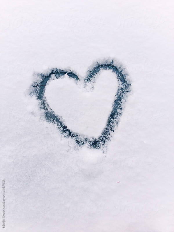 Heart drawn in a snow  by Marija Kovac for Stocksy United