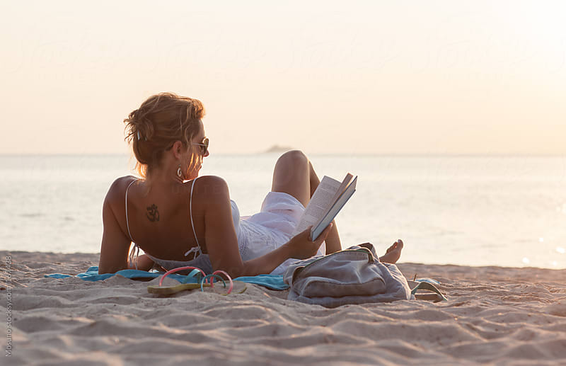 Woman Reading a Book at the Beach by Mosuno for Stocksy United