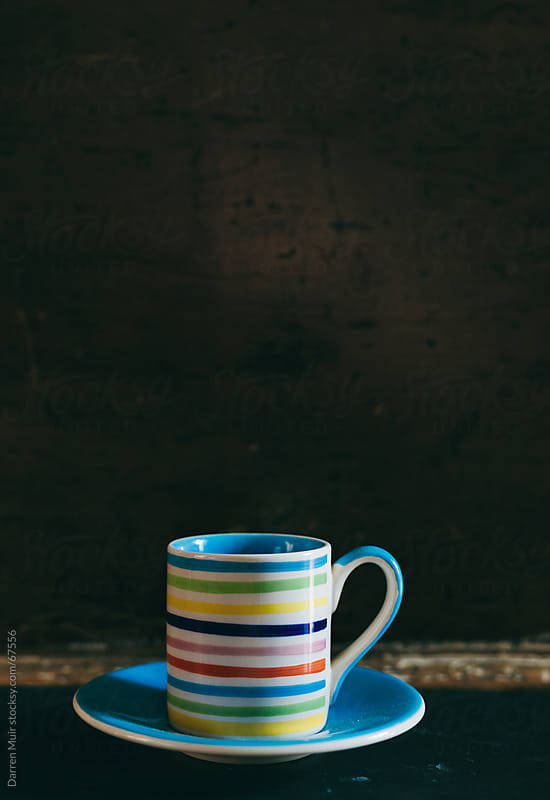 multi colored mug and saucer. by Darren Muir for Stocksy United
