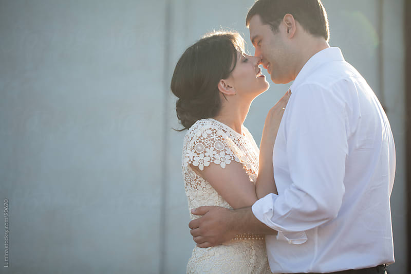 Bride and Groom Kissing  by Lumina for Stocksy United