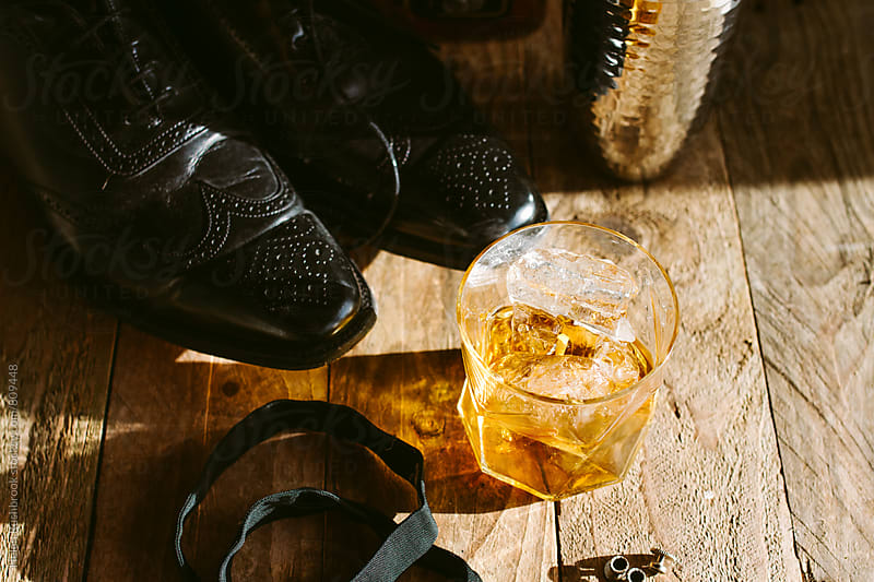 Bourbon, a proper bow-tie and brogues. by Helen Rushbrook for Stocksy United