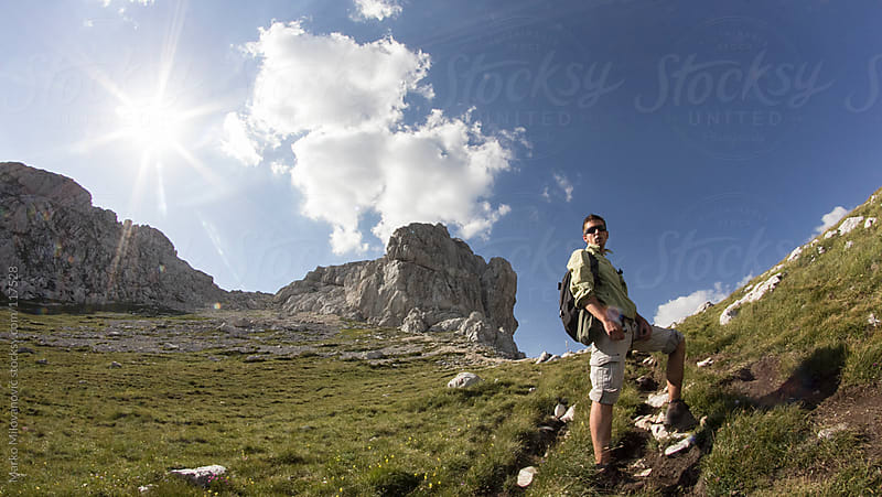 Young climber going up to the top of the mountain by Marko Milovanović for Stocksy United