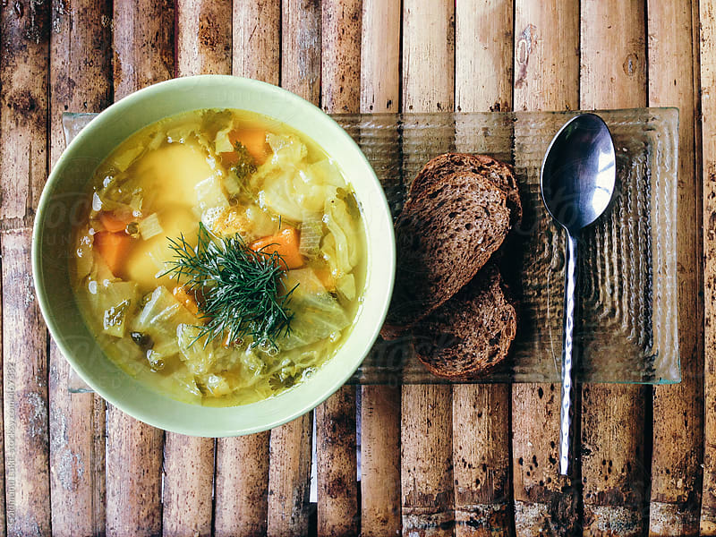 Vegetable Soup and Bread by Goldmund Lukic for Stocksy United