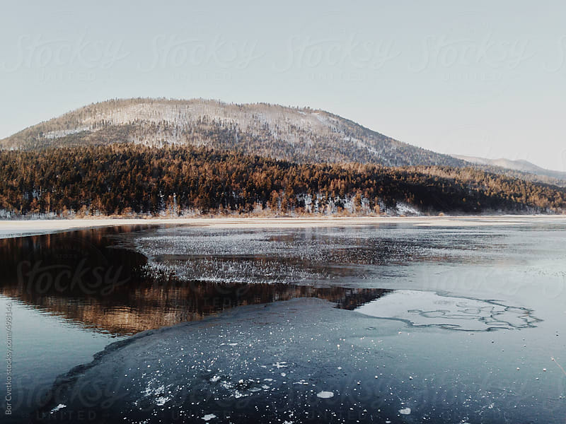 Ice on a lake by Bor Cvetko for Stocksy United