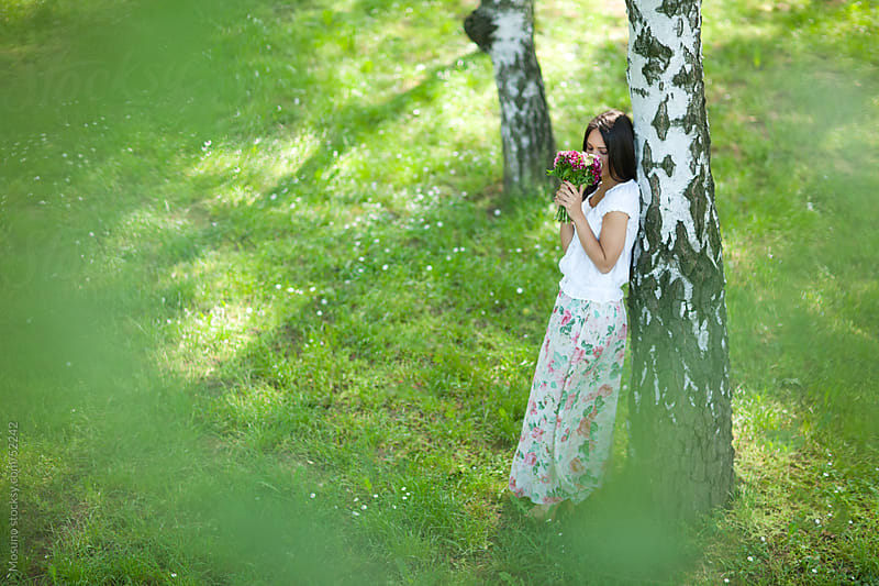 Woman enjoying spring in the park. by Mosuno for Stocksy United