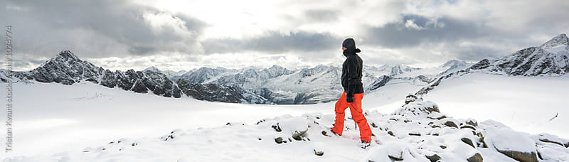 Male climber looking out over the mountains in winter by Tristan Kwant for Stocksy United