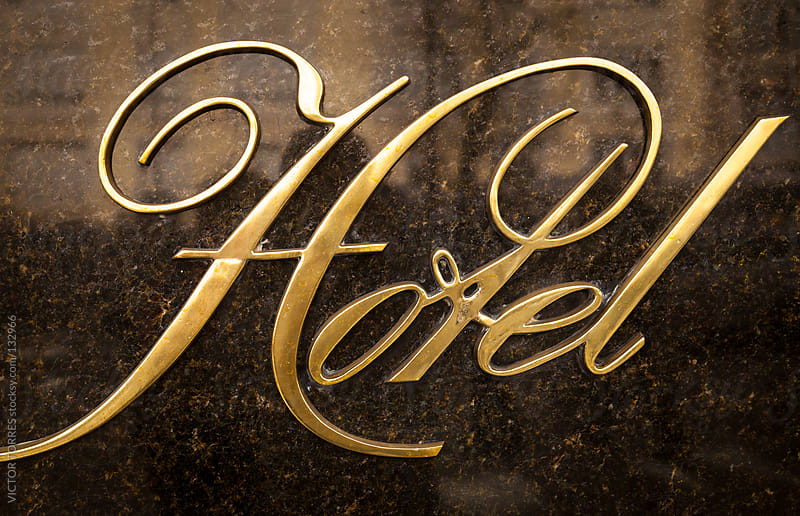 Classic Hotel Golden Sign by VICTOR TORRES for Stocksy United