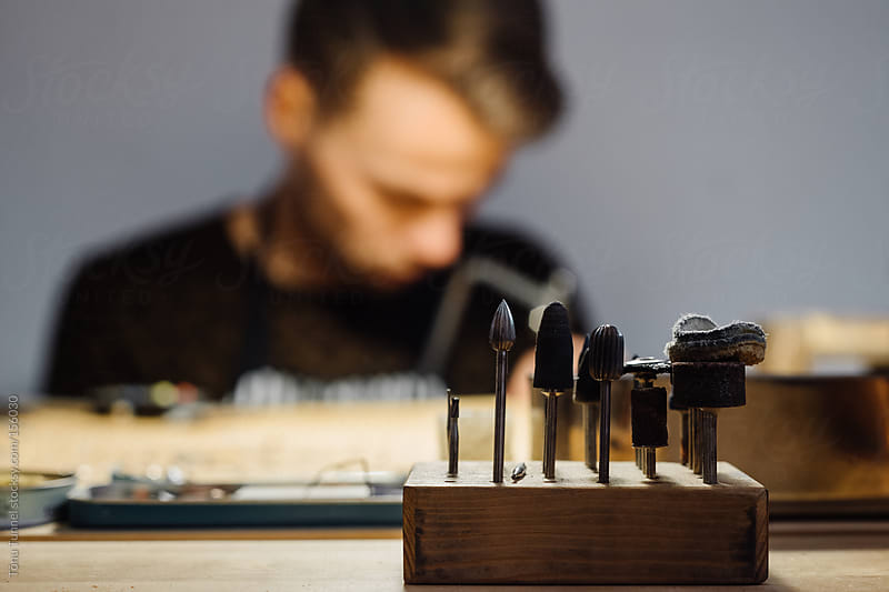 A young jeweller at his desk, out of focus by Tõnu Tunnel for Stocksy United