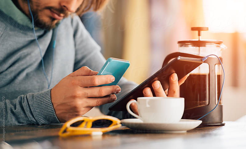Man using technology in cafe by Aila Images for Stocksy United
