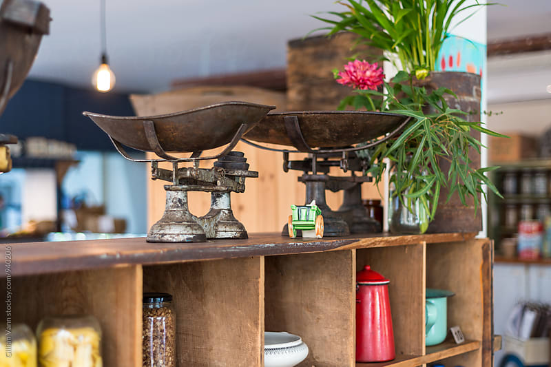 cafe interior, vintage scales on a timber shelving unit by Gillian Vann for Stocksy United