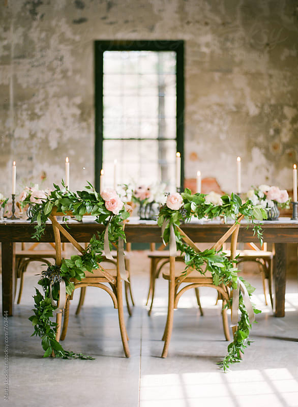 Elegant wedding chair garland by Marta Locklear for Stocksy United