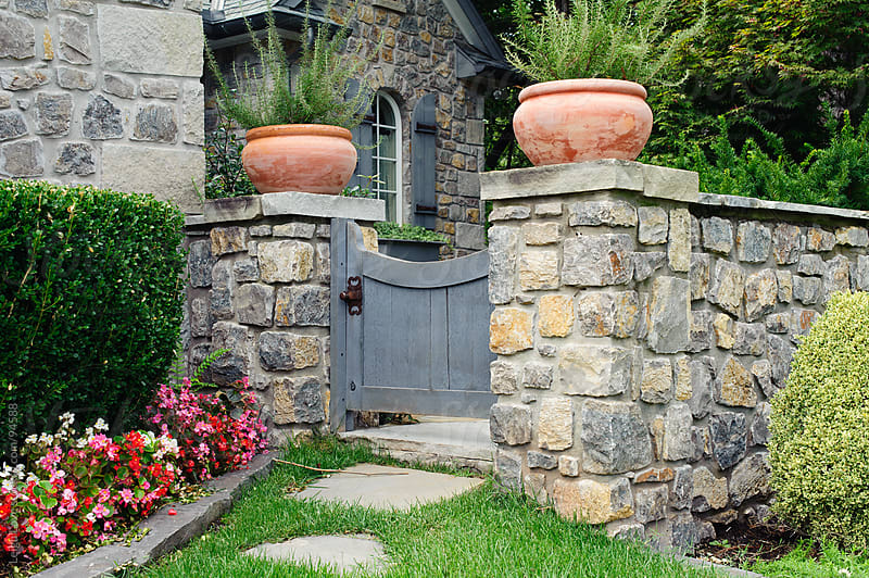 English Cottage Cobblestone Wall with Gate by Leigh Love for Stocksy United
