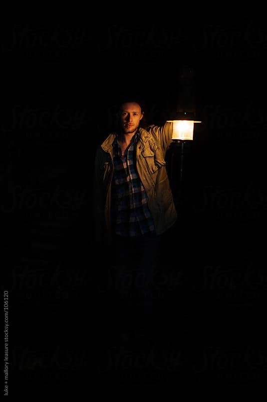 Man Holding Lantern  by luke + mallory leasure for Stocksy United
