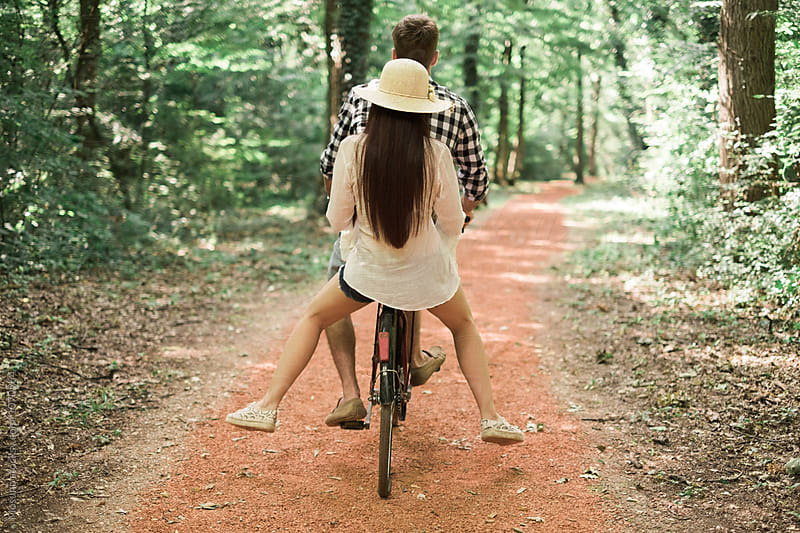 Anonymous Couple Riding a Bike in the Park by Mosuno for Stocksy United