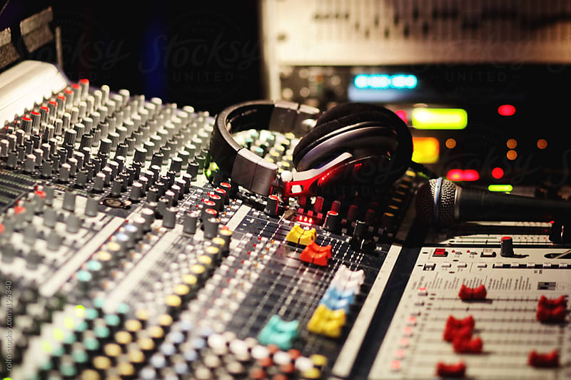 Buttons of a professional audio recording studio by rolfo for Stocksy United