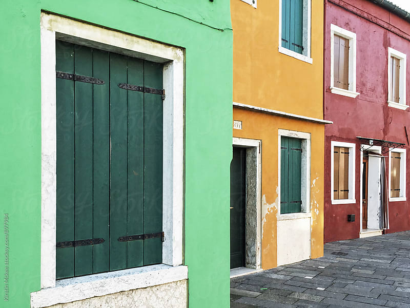 Three colourful buildings in Burano, Venice by Kirstin Mckee for Stocksy United