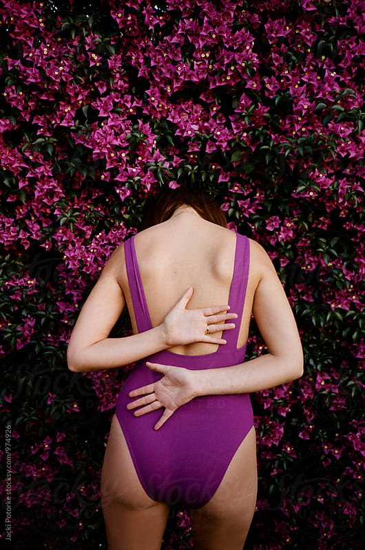 Head in the Flowers by Jacki Potorke for Stocksy United