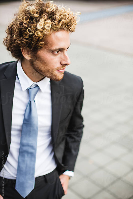 Portrait of young businessman in a suit and tie by michela ravasio for Stocksy United