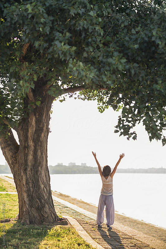 Woman Spreading Arms Out Under a Tree by Lumina for Stocksy United