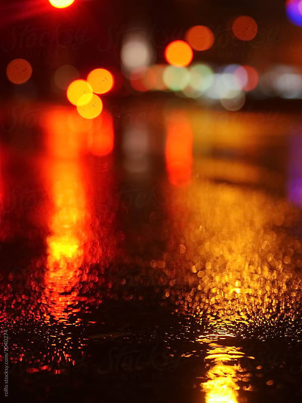 Bright wet road in traffic lights at night by rolfo for Stocksy United