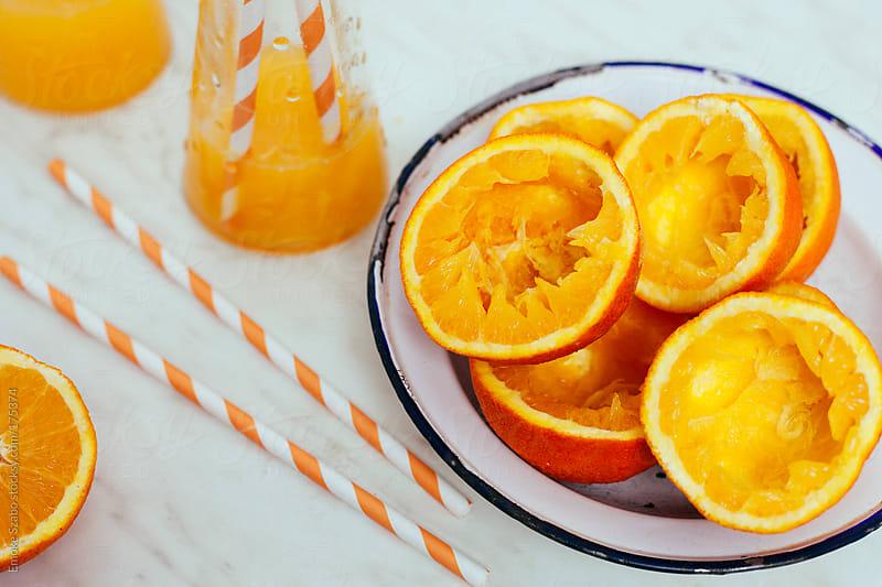 Squeezed oranges by Emoke Szabo for Stocksy United