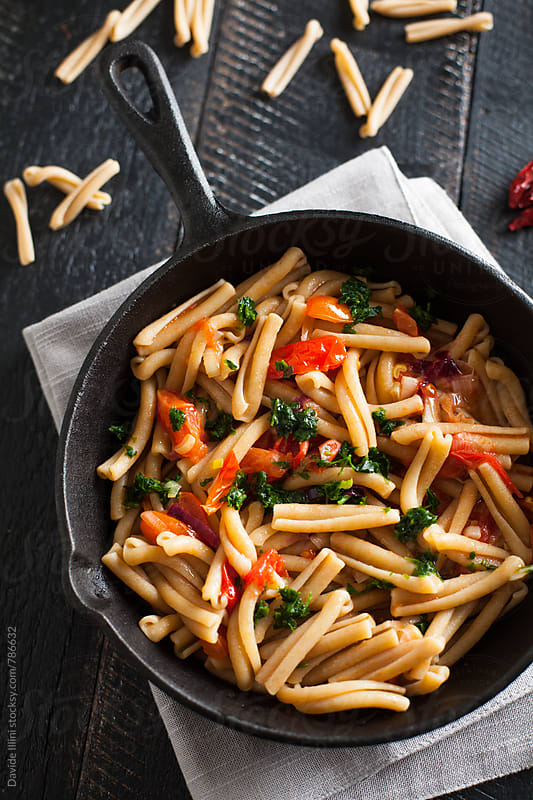 Wheat pasta with fresh tomatoes by Davide Illini for Stocksy United