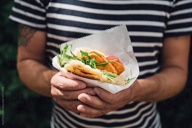 Streetfood: Cuban Arepa Burger, vegan by Ina Peters for Stocksy United