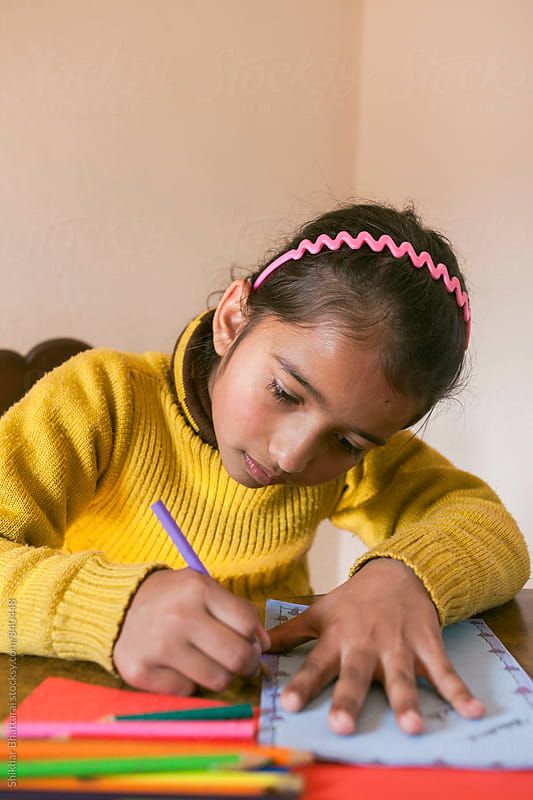 Close up of a young child making a christmas card. by Shikhar Bhattarai for Stocksy United