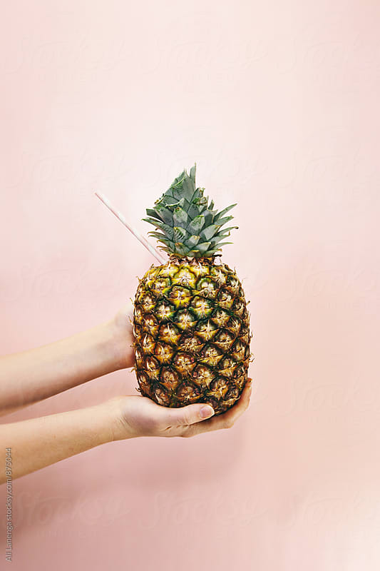 Pineapple with a straw by Ali Lanenga for Stocksy United