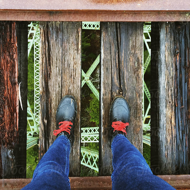 Standing on the Vance Creek Bridge by Bethany Olson for Stocksy United