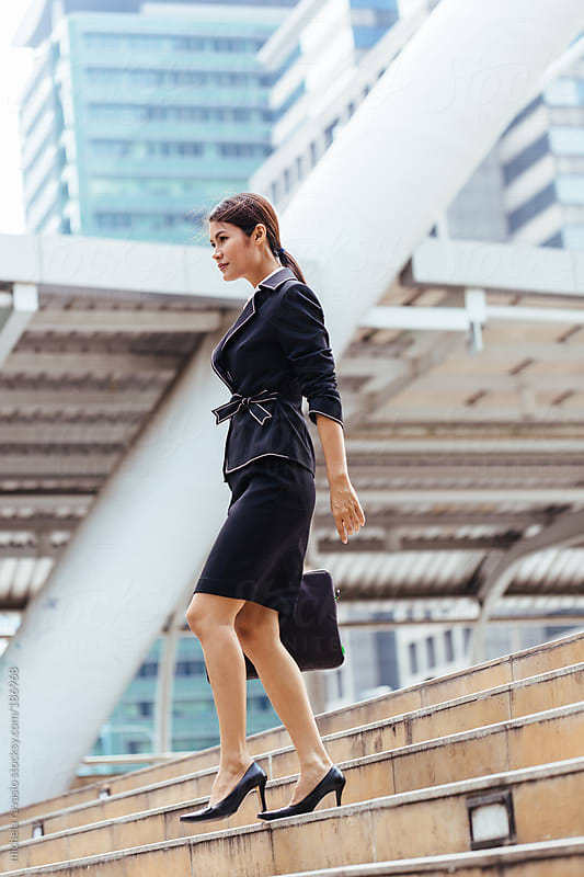 Business woman walking by michela ravasio for Stocksy United