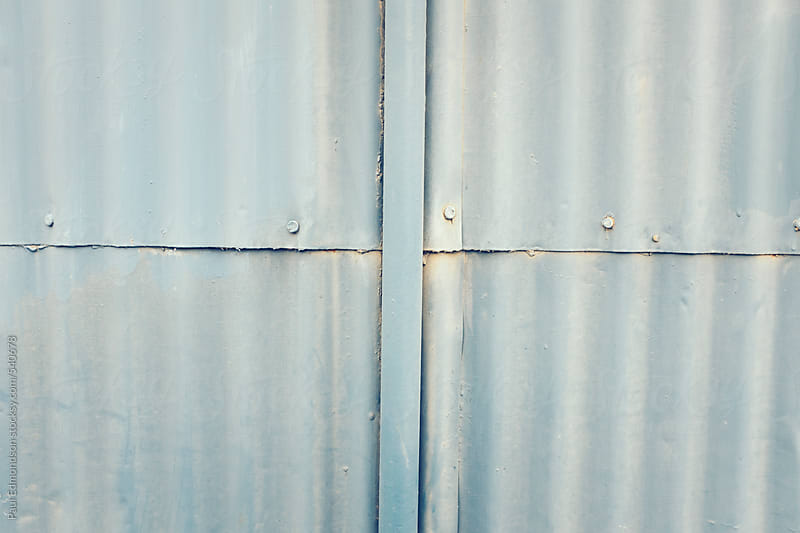 Detail of old metal, corrugated siding on warehouse exterior by Paul Edmondson for Stocksy United