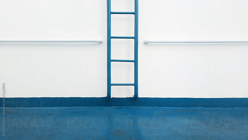 blue leather and white wall composition by Sonja Lekovic for Stocksy United