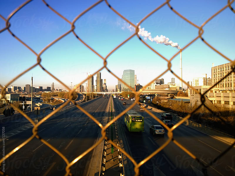 The barbed wire fence and highway  by zheng long for Stocksy United