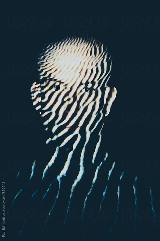 Portrait of man with color infrared sand dune patterns covering body by Paul Edmondson for Stocksy United