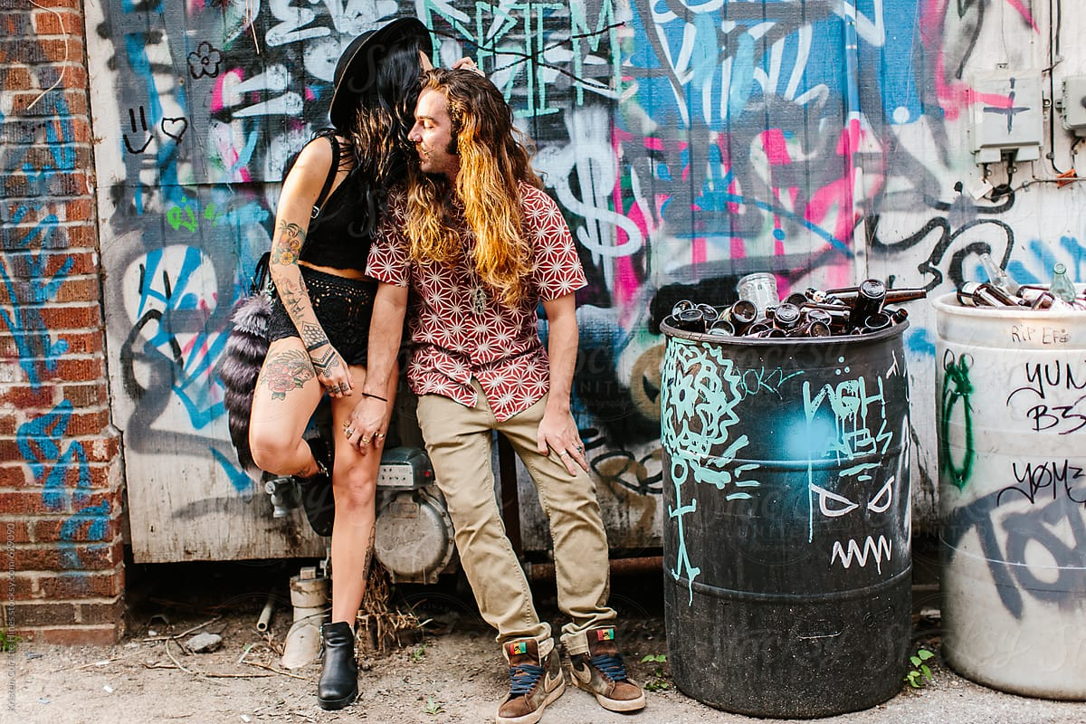 two graffiti artists hanging out in an alleyway stocksy united