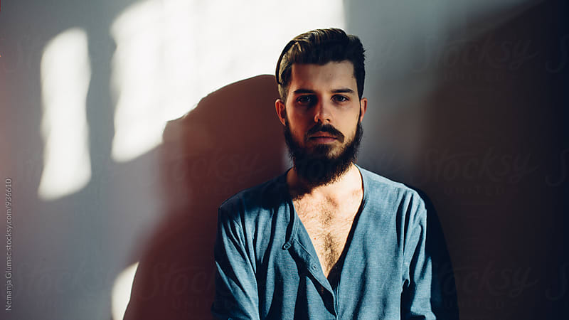 Handsome Bearded Man With Shadows Falling Across His Face. by Nemanja Glumac for Stocksy United
